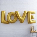 Ballon géant Love doré
